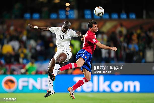 Stephen Appiah of Ghana and Dejan Stankovic of Serbia jump for the ball during the 2010 FIFA World Cup South Africa Group D match between Serbia and...