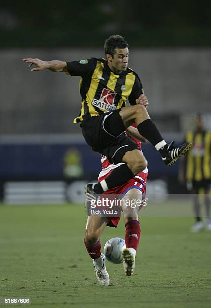 Stephen Armstrong of the Charleston Battery battles for control of the ball from Andre Rocha of the FC Dallas July 8 2008 at Pizza Hut Park in Frisco...