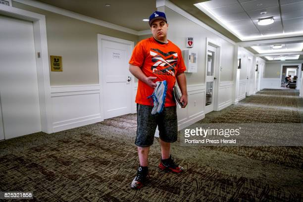Stephen Barber of Westbrook lets out a sigh while standing at the crossroads of a hallway at the Serenity at Summit rehabilitation center in...