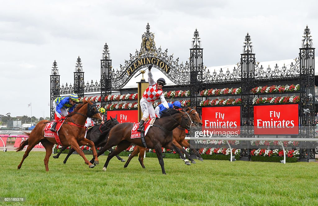 Stephen Baster riding Awesome Rock defeats Seaburge and Hauraki in Race 7, Emirates Stakes on Stakes Day at Flemington Racecourse on November 5, 2016 in Melbourne, Australia.