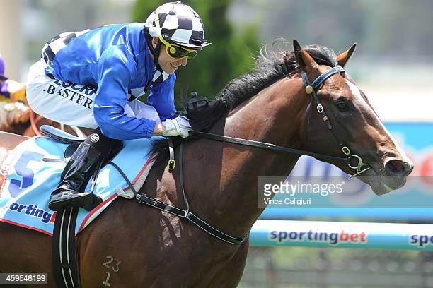 Stephen Baster riding Chivalry wnning Race 1 Quest Moonee Valley Plate during Melbourne Racing at Moonee Valley Racecourse on December 28 2013 in...