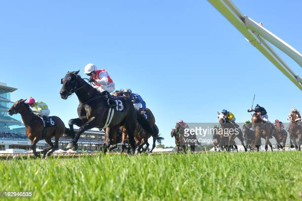 Stephen Baster riding Ferlax wins the Australian Guineas from Vlad Duric riding You're So Good and Michael Rodd riding Sheer Talent during Melbourne...