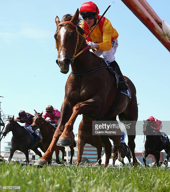 Stephen Baster riding Of the Brave leads the field across the line to win the Inglis Debutant Stakes during Caulfield Guineas Day at Caulfield...