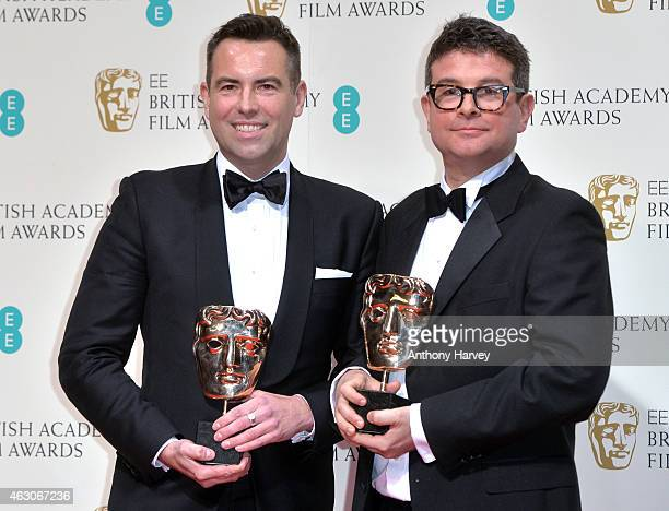 Stephen Beresford and David Livingstone winners of Outstanding Debut by a British Writer Director or Producer for 'Pride' pose in the winners room at...