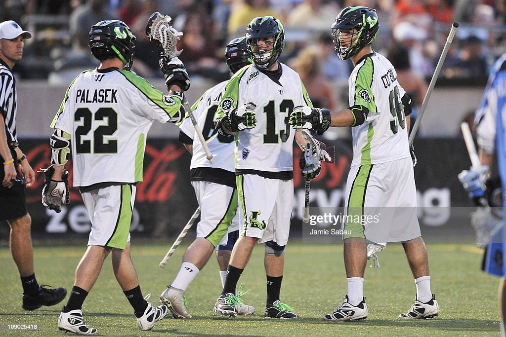 Stephen Berger #13 of the New York Lizards celebrates a goal against the Ohio Machine in the second period with teammates Tommy Palasek #22 and CJ Costabile #96 on May 18, 2013 at Selby Stadium in Delaware, Ohio. New York defeated Ohio 14-8.
