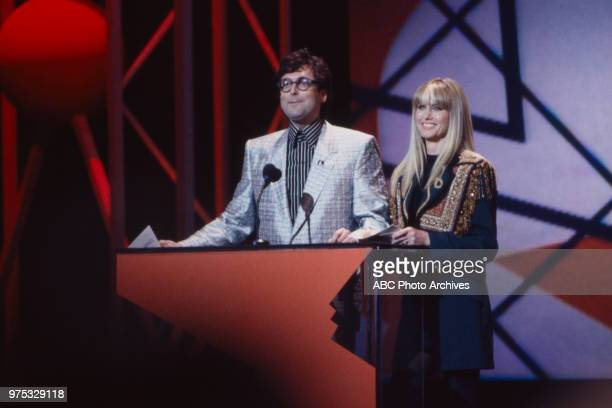 Stephen Bishop Olivia NewtonJohn presenting on the 17th Annual American Music Awards Shrine Auditorium January 22 1990