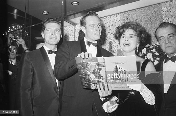 Stephen Boyd Charleton Heston and Haya Harareet at the opening of BenHur in which they each have starring roles | Location Loews State Theatre New...