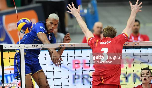 Stephen Boyer of France spikes against Sam Deroo of Belgium during the group D match between France and Belgium of the 2017 CEV Men's Volleyball...