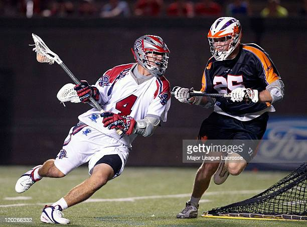 Stephen Boyle of the Boston Cannons drives to his right on the way to the goal against Mike Timms of the Toronto Nationals on July 24 2010 at Harvard...