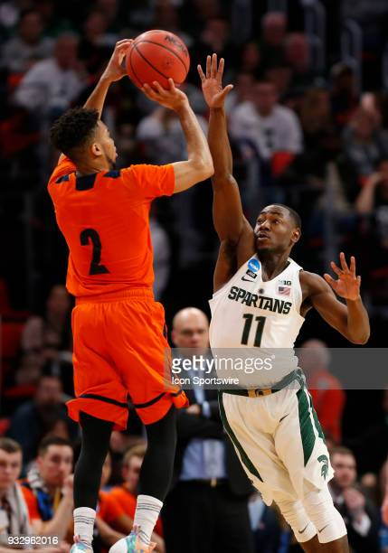 Stephen Brown of the Bucknell Bison shoots over G Lourawls Nairn of the Michigan State Spartans during the NCAA Division I Men's Basketball...