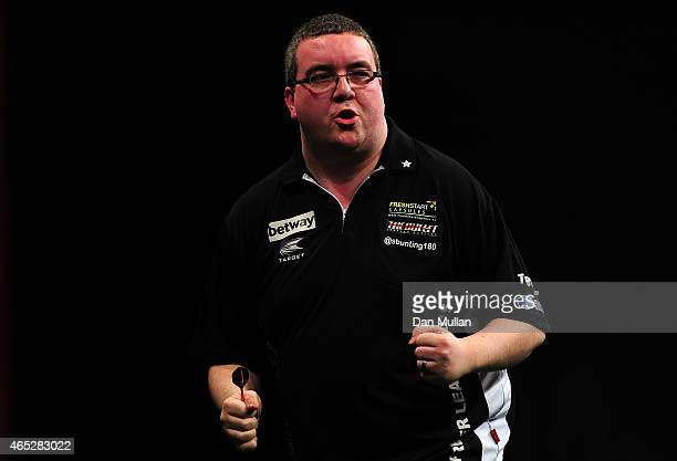 Stephen Bunting of England celebrates after winning a leg against Adrian Lewis of England during The Betway Premier League Darts at Westpoint Arena...