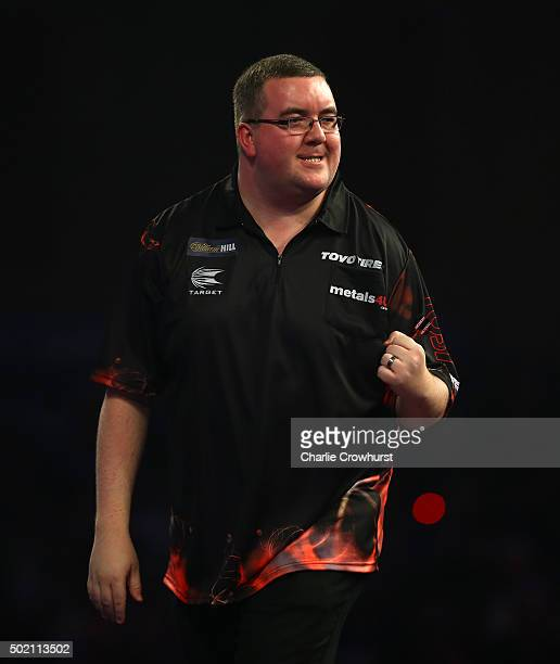 Stephen Bunting of England celebrates winning his first round match against Jyhan Artut of Germany during the 2016 William Hill PDC World Darts...