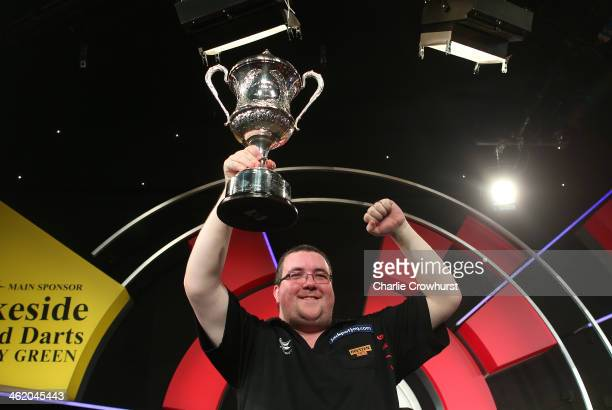 Stephen Bunting of England celebrates with the trophy after winning the final against Alan Norris of England during the BDO Lakeside World...