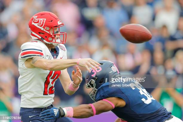Stephen Calvert of the Liberty Flames throws a pass during the first quarter of the 2019 Cure Bowl against Georgia Southern Eagles at Exploria...