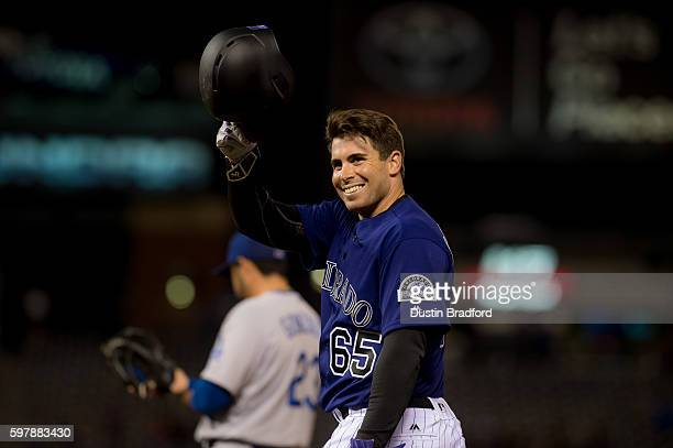 Stephen Cardullo of the Colorado Rockies tips his hat to the crowd after hitting a single for his first major league hit off of JP Howell of the Los...