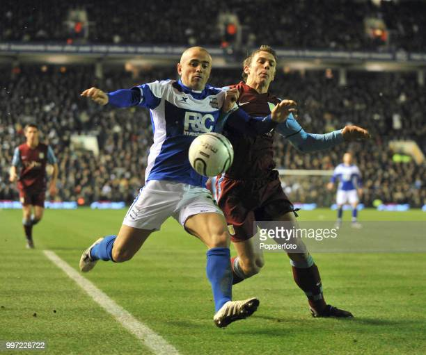 Stephen Carr of Birmingham City and Stephen Warnock of Aston Villa battle for the ball during an Carling Cup Quarter Final at St Andrews on December...