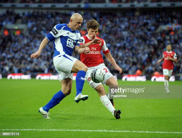Stephen Carr of Birmingham City battles with Andrey Arshavin of Arsenal during the Carling Cup Final between Arsenal and Birmingham City at Wembley...
