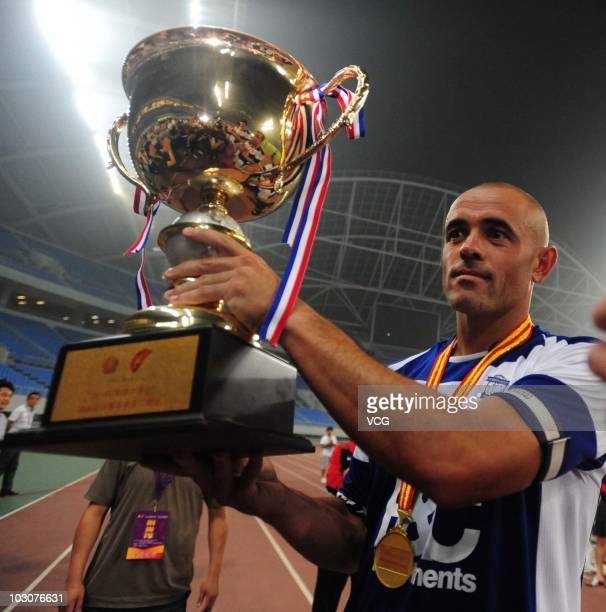 Stephen Carr of Birmingham City holds aloft the winners trophy after the 2010/11 preseason friendly match between Liaoning Hongyun and Birmingham...