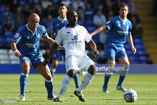 Stephen Carr of Birmingham City keeps an eye on Darius Vassell of Leicester City during the npower Championship match at St Andrews on October 16...