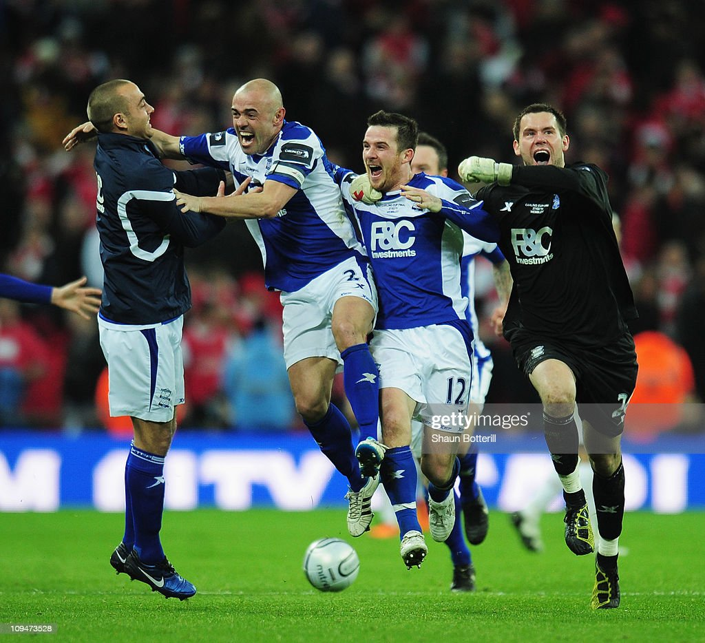 Stephen Carr (2ndL) of Birmingham City leads the celebrations with Barry Ferguson and Ben Foster (R) after the Carling Cup Final between Arsenal and Birmingham City at Wembley Stadium on February 27, 2011 in London, England.