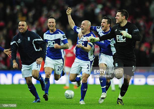 Stephen Carr of Birmingham City leads the celebrations with team mates after the Carling Cup Final between Arsenal and Birmingham City at Wembley...