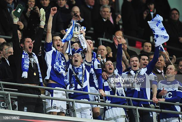 Stephen Carr of Birmingham City lifts the trophy after victory during the Carling Cup Final between Arsenal and Birmingham City at Wembley Stadium on...
