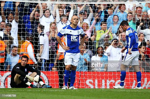 Stephen Carr of Birmingham City looks dejected with Ben Foster and Barry Ferguson after the second goal by Roman Pavlyuchenko of Tottenham Hotspur...
