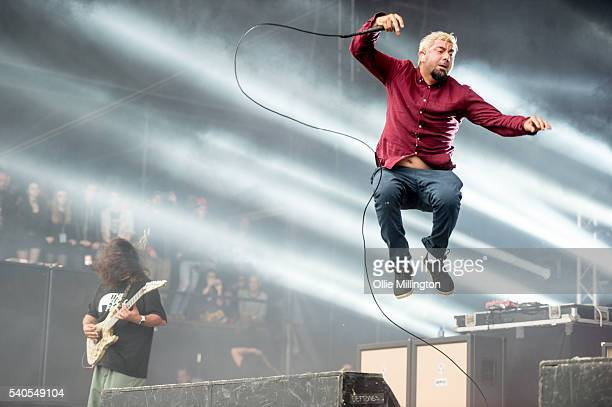 Stephen Carter and Chino Moreno of Deftones perform onstage on Day 2 of Download Festival 2016 at Donnington Park on June 11 2016 in Donnington...