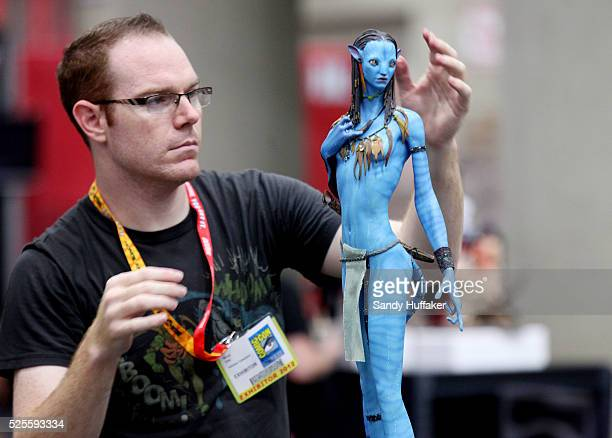 Stephen Cassiola prepares an Avatar figurine while setting up his booth at ComicCon at the San Diego Convntion Center in San Diego CA on Wednesday...