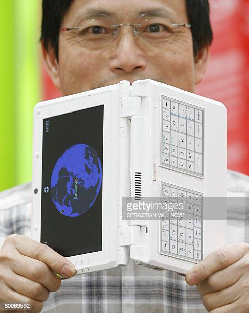 Stephen Chen of Taiwanese company ELead presents a foldable laptop with an integrated navigation system at the CeBIT 2008 trade fair on March 3 2008...