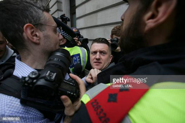 Stephen Christopher YaxleyLennon AKA Tommy Robinson former leader of the rightwing EDL is escorted away by police from a Britain First march and an...