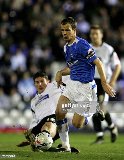 Stephen Clemence of Birmingham City avoids a tackle by Jon Macken of Derby County during the CocaCola Championship match between Birmingham City and...