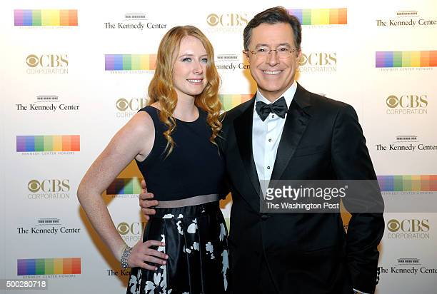 Stephen Colbert and his daughter Madeleine walk the red carpet before the Kennedy Center Honors December 06 2015 in Washington DC The honorees...