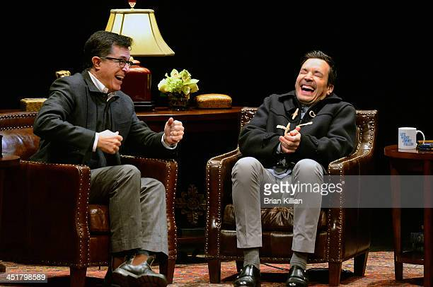 Stephen Colbert and Jimmy Fallon chat during rehearsal at New Jersey Performing Arts Center on November 24 2013 in Newark New Jersey