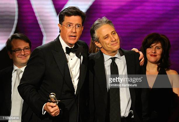Stephen Colbert and Jon Stewart speak onstage at the First Annual Comedy Awards at Hammerstein Ballroom on March 26 2011 in New York City