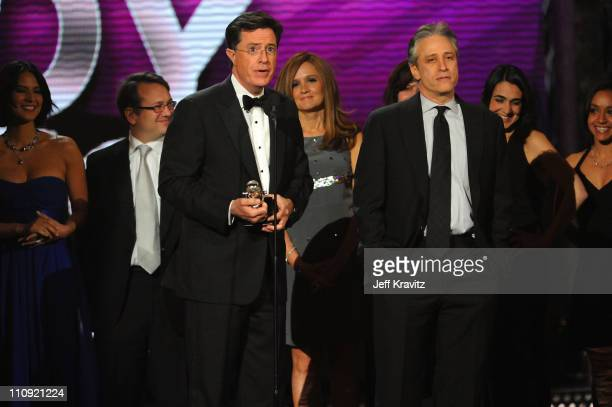 Stephen Colbert and Jon Stewart speak onstage at the First Annual Comedy Awards at Hammerstein Ballroom on March 26, 2011 in New York City.