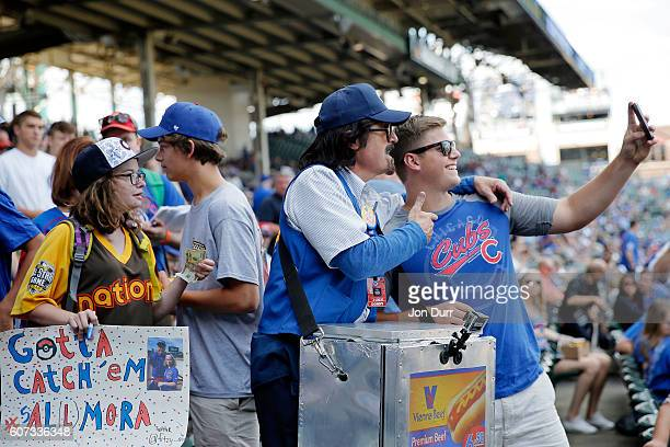 Stephen Colbert playing the role of Wrigley Field hot dog vendor Donny Franks takes a selfie with a fan during filming for a special segment before...
