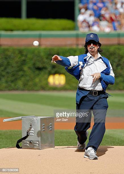 Stephen Colbert playing the role of Wrigley Field hot dog vendor Donny Franks throws out a ceremonial first pitch before the game between the Chicago...