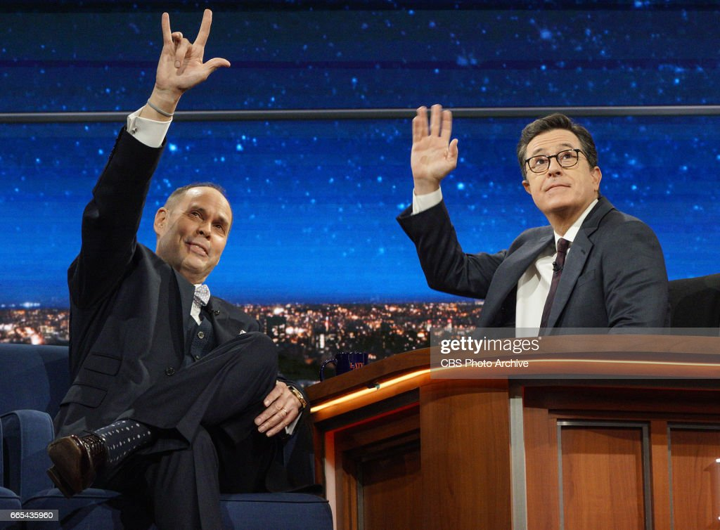 Stephen Colbert talks with Ernie Johnson Jr. as they wave to Ernie's son during Tuesday's 4/4/17 taping in New York.