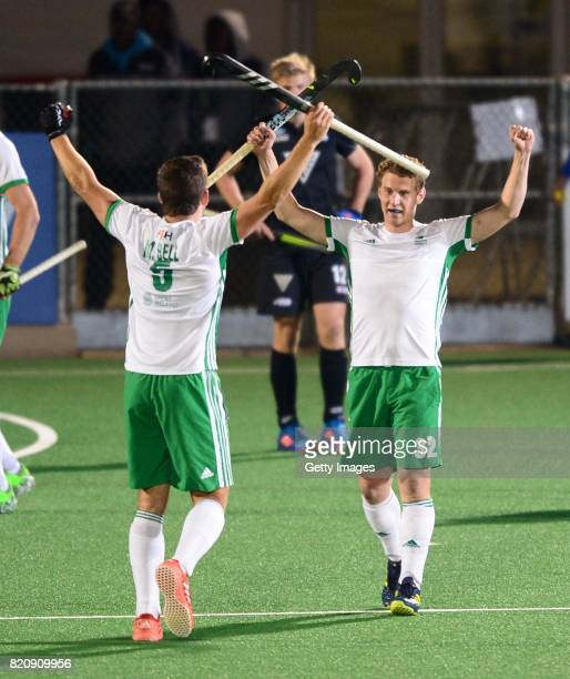 Stephen Cole and Matthew Bell of Ireland celebrate during day 8 of the FIH Hockey World League Men's Semi Finals 5th6th place match between New...