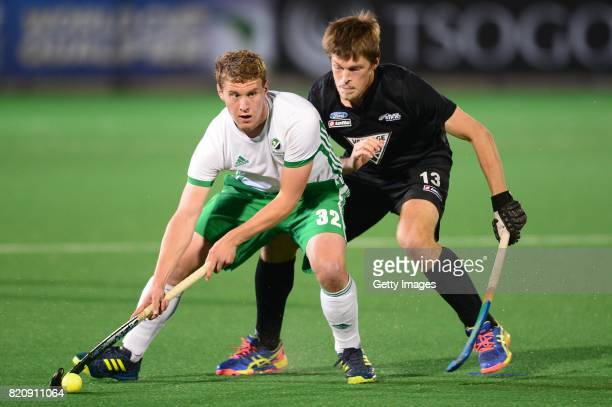 Stephen Cole of Ireland and Marcus Child of New Zealand during day 8 of the FIH Hockey World League Men's Semi Finals 5th6th place match between New...