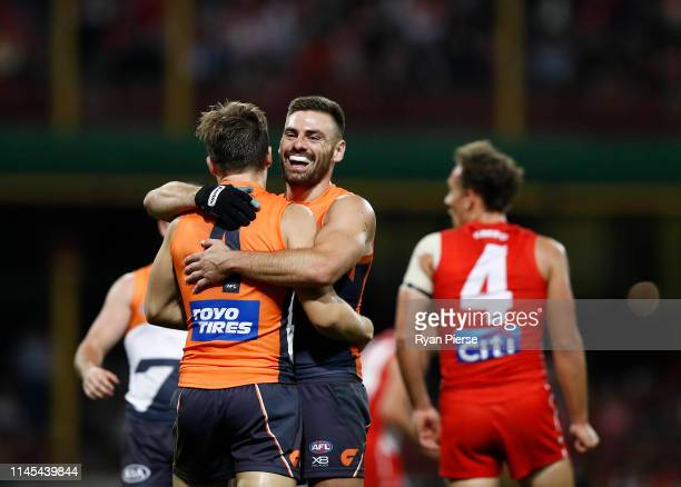 Stephen Coniglio of the Giants celebrates a goal during the round 6 AFL match between the Sydney Swans and GWS Giants at Sydney Cricket Ground on...