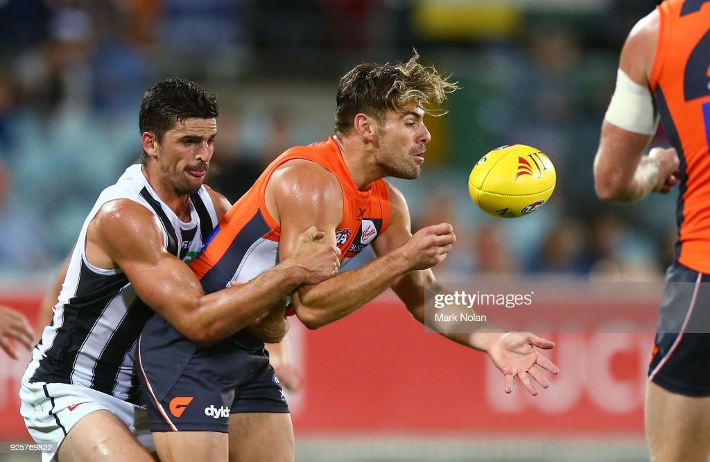 Stephen Coniglio of the Giants handballs during the JLT Community Series AFL match between the Greater Western Sydney Giants and the Collingwood Magpies at UNSW Canberra Oval on March 1, 2018 in Canberra, Australia.