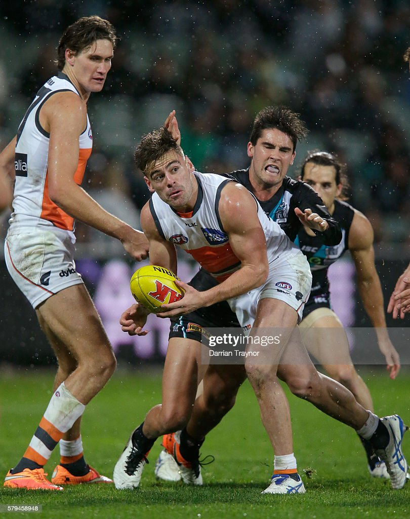 Stephen Coniglio of the Giants handballs during the round 18 AFL match between the Port Adelaide Power and the Greater Western Sydney Giants at Adelaide Oval on July 24, 2016 in Adelaide, Australia.