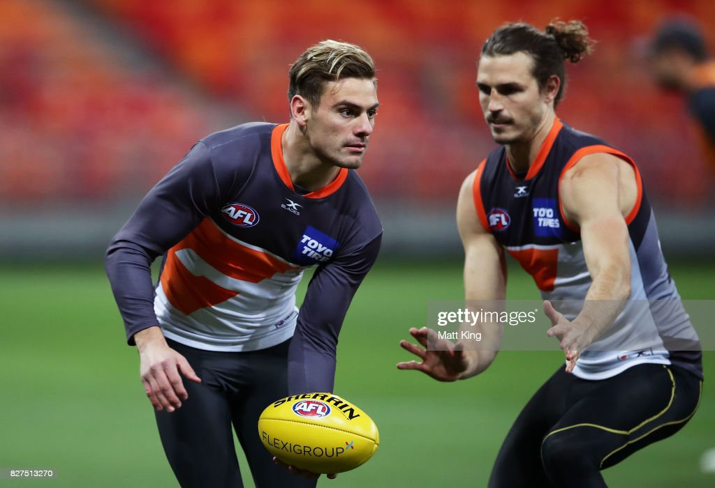 Stephen Coniglio of the Giants handles the ball during a Greater Western Sydney Giants AFL training session at Spotless Stadium on August 8, 2017 in Sydney, Australia.