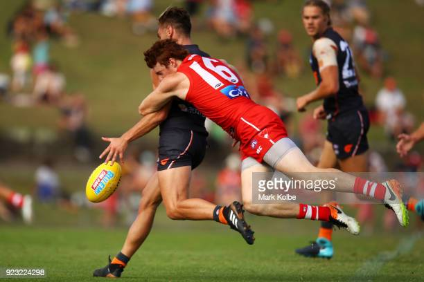 Stephen Coniglio of the Giants is tackled Gary Rohan of the Swans during the AFL Inter Club match between the Sydney Swans and the Greater Western...