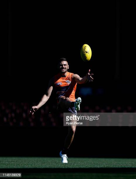 Stephen Coniglio of the Giants kicks for goal during a GWS Giants AFL training session at SCG on April 26, 2019 in Sydney, Australia.