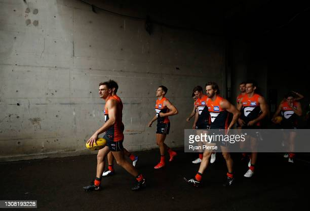 Stephen Coniglio of the Giants leads his team outnduring the round one AFL match between the GWS Giants and the St Kilda Saints at GIANTS Stadium on...