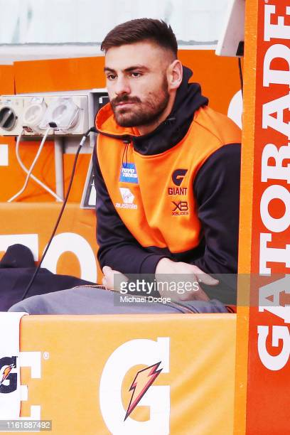 Stephen Coniglio of the Giants looks dejected after he injures his leg during the round 17 AFL between the Richmond Tigers and the Greater Wester...
