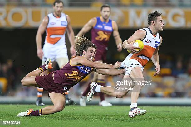 Stephen Coniglio of the Lions is tackled by Rhys Mathieson of the Lions during the round 17 AFL match between the Brisbane Broncos and the Greater...